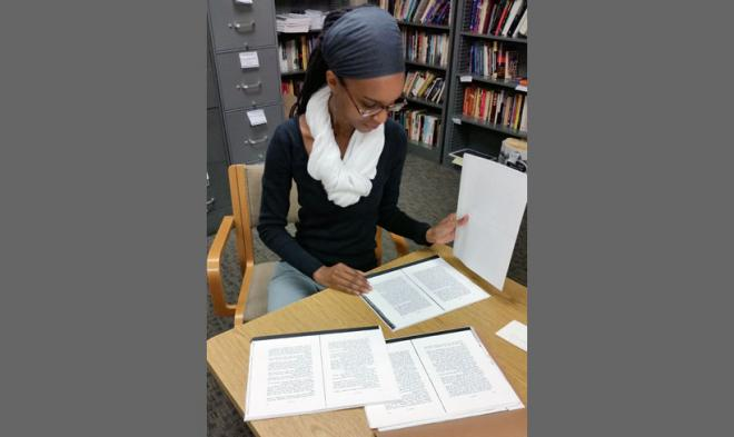 HBW staff member Kristin Coffey working with recovered manuscripts.