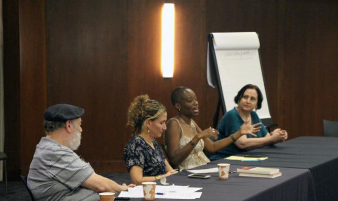 """Professor Giselle Anatol speaks during the panel """"Immigrants and Natives: America's Past and Present"""""""