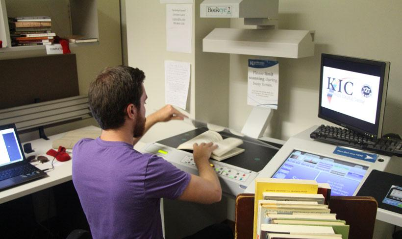 Connor Noteboom scans novels for the Digital Inclusion Group Initiative.