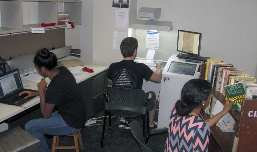 The scanning team for DIGIN (left to right): Dominique Waller, Connor Noteboom, and Mona Ahmed. Not pictured: Matthew Broussard.