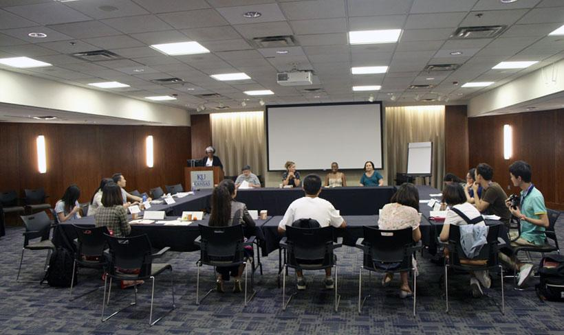 """Maryemma Graham introduces the panel """"Immigrants and Natives: America's Past and Present,"""" featuring professors David Katzman, Marta Caminero-Santangelo, Stephanie Fitzgerald, and Giselle Anatol."""