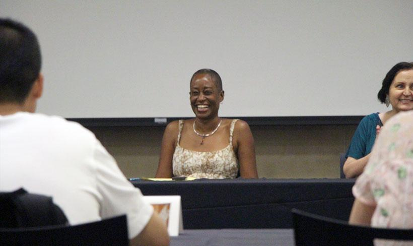 Professor Giselle Anatol listens to a question from a BFSU scholar.